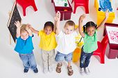 stock photo of multicultural  - young preschool children in classroom - JPG