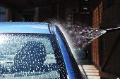 stock photo of car wash  - Blue car washing on open air - JPG