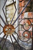 pic of burial-vault  - Detail shot of a wrought iron gate in cemetery number one in New Orleans - JPG