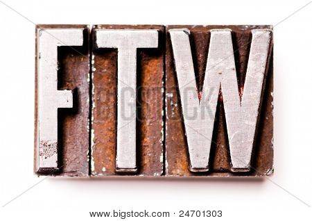 "The phrase ""FTW"" in letterpress type. Cross processed, narrow focus."