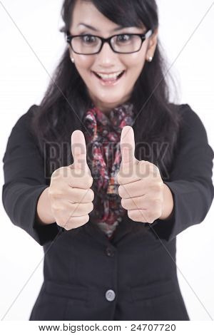 Happy Businesswoman With Thumbs-up
