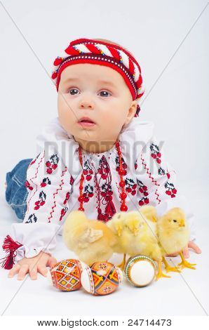 Little Girl With Easter Eggs And Baby Chickens