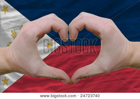Heart And Love Gesture Showed By Hands Over Flag Of Phillipines Background