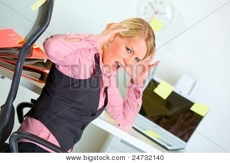Shocked By Set Of Tasks Business Woman Sitting At Workplace Covered With Sticky Notes