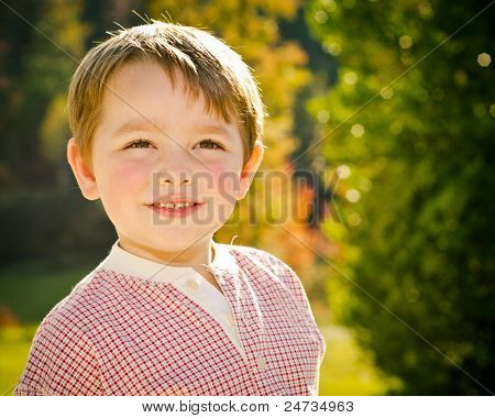Fall or autumn portrait of happy young boy