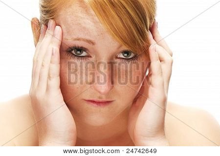 young redhead woman suffering on headache