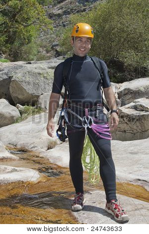 Men In River With Equipment To Canyoning