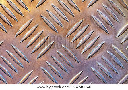 Hintergrundfoto von einem metallischen Industrieboden mit holprigen Muster