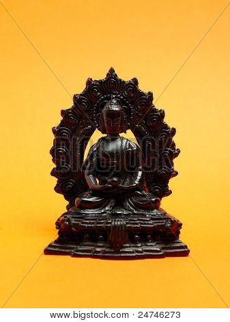 Statue Of Ancient Meditating Monk Made Of Wood