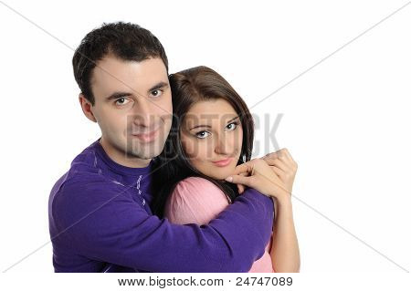 Lovely Young Family In Love Embracing