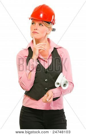 Thoughtful Modern Architect Woman With Flip Charts Looking In Corner