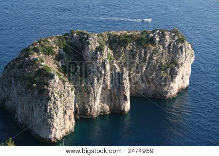 Italy. Island Capri. Small Faraglioni