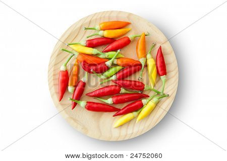 colorful chili peppers plate isolated on white background