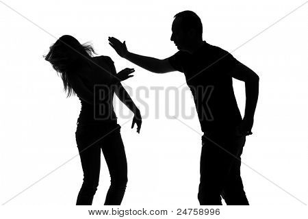 Silhouette of a man slapping a woman isolated against white background