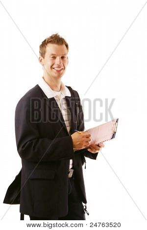 Caucasian businessman writing notes and smiling at the camera isolated on white background