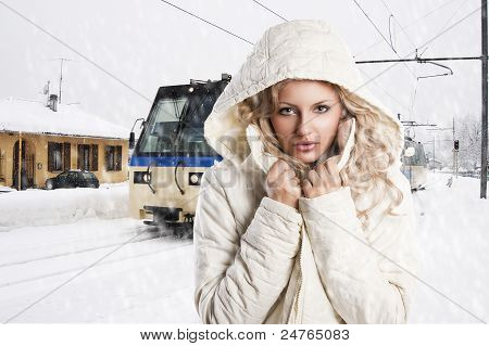 Girl With White Hood, She's Adjusting The Neck Of The Jacket