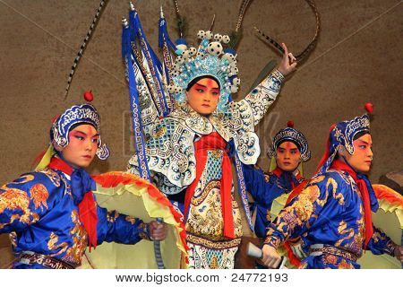 BEIJING, CHINA - NOVEMBER 16: Artists acting as soldiers and a general perform a Peking opera show on November 16, 2005 in Beijing, China. The story depicts heroic battles fought in ancient China.