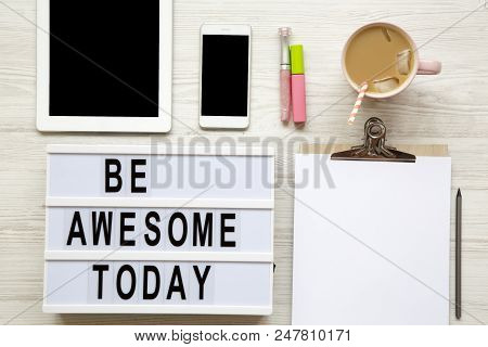 poster of Feminine Workplace With Tablet, Noticepad, Sheet, Latte Ice And 'be Awesome Today' Words On Modern B