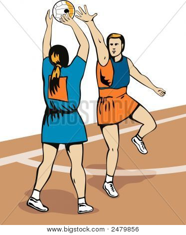 Netball Player Attempting To Block The Shot
