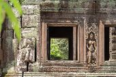 Ancient Stone Ruin Of Banteay Kdei Temple, Angkor Wat, Cambodia. Ancient Temple Window To Green Fore poster