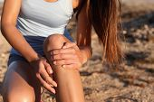 Medical health sport injury runner woman with hurting knee. Sports fitness athlete touching knees wi poster