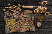 Treasure Map, Compass And Shovel Full Of Gold Nuggets Ore On Wooden Table. Treasure Hunter Or Gold M poster