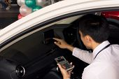 This Asian Man Calculating Calculator In Car Career Saleman For Business Finance On Car Showroom Blu poster