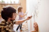 Father And Daughter Repairing Wall, Holding Putty Knife, Family Activity. Copy Space. poster