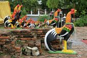 foto of roster  - Statues of rosters near temple in Wat Thummikarat Ayutthaya Thailand - JPG