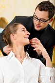 stock photo of collier  - Man giving his wife a necklace as a gift - JPG