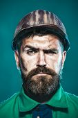 Construction Worker In Hard Hat. Builder In Protective Clothing And Helmet. Male Builder. Portrait B poster