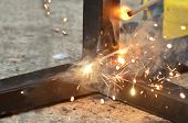 Spark From Weld Work When Welder Welding An Iron, Steel Structure In A Construction Site, Industrial poster
