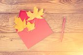 Red Envelope With Autumn Leaves. Autumn Letter. Maple Leaves In Red Envelope, Red Pen On Wooden Back poster