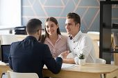 Insurance Agent Or Broker Consulting Smiling Millennial Couple On Property Purchase, Realtor Discuss poster