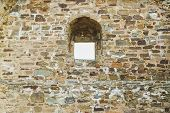 Brick Wall With Arched Masonry poster