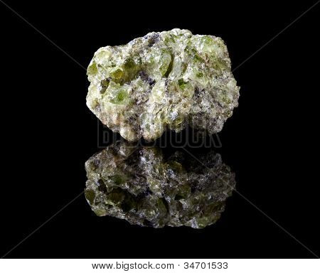 Rough peridote or chrysolite, the gemstone of August, and the mineral olivine