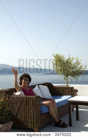 Tourist Relaxing In Santorini
