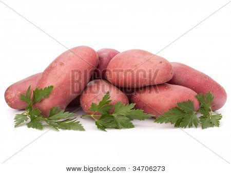 New potato tuber heap and parsley leaves isolated on white background cutout