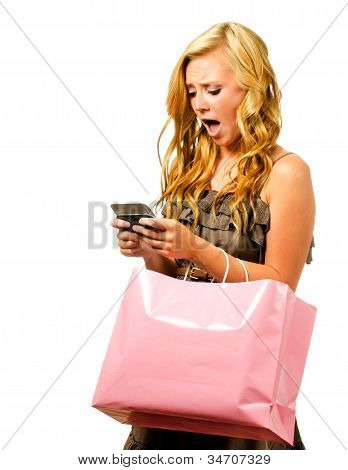 Portrait of teen girl with pink shopping bag texting with shocked or surprised expression isolated o