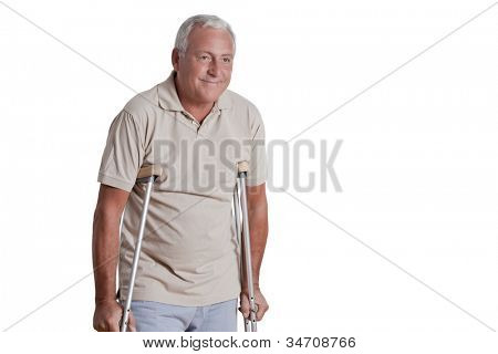 Senior man with crutches and females doing physical exercise .