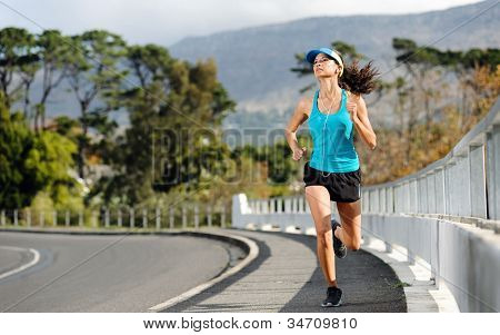 Endurance athlete training on sidewalk, running fitness marathon woman. exercise healthy lifestyle concept.