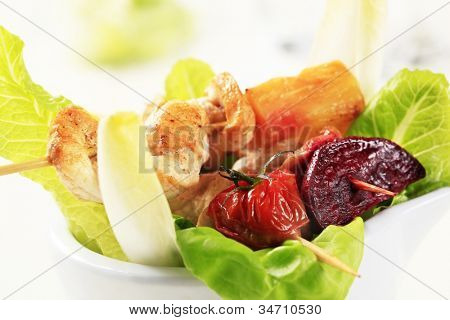 Three fried meat gulps with vegetables on a white tray