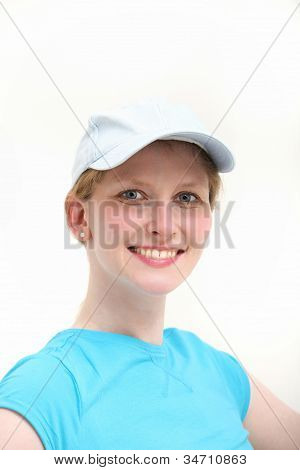 Smiling woman in white baseball cap