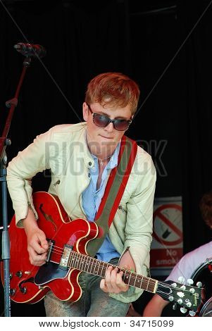 TENTERDEN, ENGLAND - JUNE 30: Ollie Bond, lead singer  of British blues group The Electric Church performs at the annual Tentertainment music festival on June 30, 2012 at Tenterden, Kent, England.
