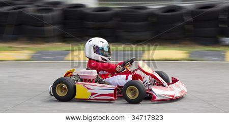 Asian boy in a go kart