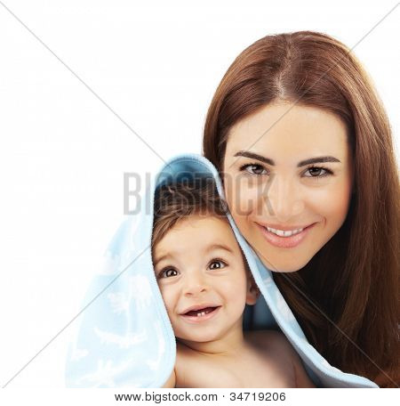 Sweet little baby boy with mother isolated on white background, portrait of happy cheerful kid wrapped in blue towel with lovely mommy, conceptual of love, health care, new family lifestyle