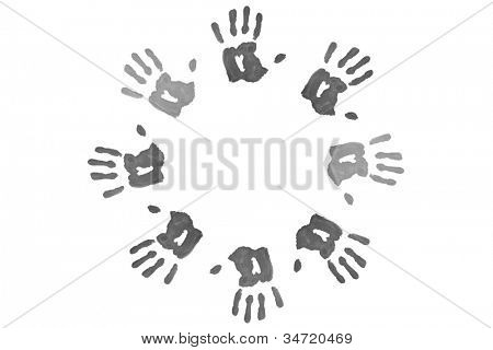 Black hand prints forming a circle against a white background