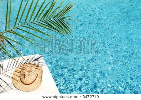Straw Hat By A Swimming Pool