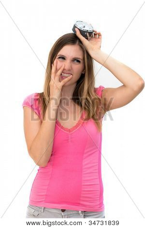 Too late,young beautiful woman holding a clock on a white background