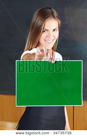 Happy smiling woman holding empty green sign